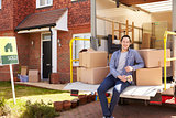 Man Unpacking Moving In Boxes From Removal Truck