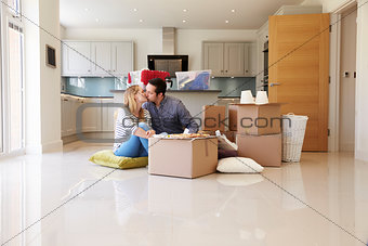 Couple Celebrating Moving Into New Home With Pizza
