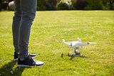 Close Up Of Man Flying Drone Quadcopter In Garden
