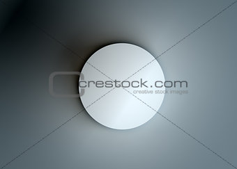 Top view of a white cylinder. Dark background