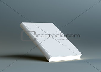 A closed white empty book stands on the corner