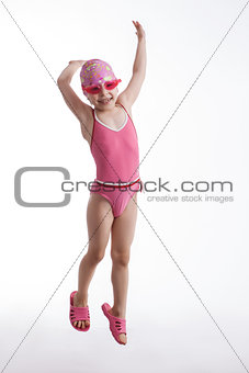 Little girl in a pink swimsuit
