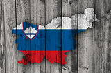 Map and flag of Slovenia on weathered wood