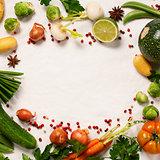 Frame of organic vegetables on white