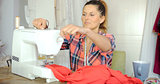 Female using sewing machine