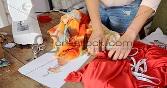 Crop seamstress choosing fabric for dress