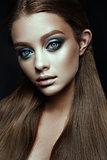 Fashion model Woman with fantasy make up. Long blowing brown hair.