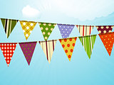 Vintage colorful bunting over sky background