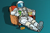 Astronaut the audience with beer and popcorn sitting in a chair