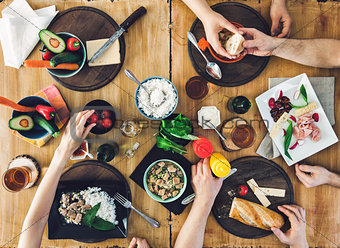 Top view, Group of people sitting at the table having meal