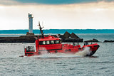 Red pilot ship sailing to Baltic sea