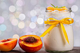 yogurt with peaches, bokeh background, closeup