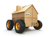 Cardboard house box with wheels isolated on white background. Mo