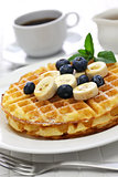 homemade american round waffles with blueberry and banana