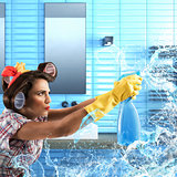 Housewife cleans with soap spray