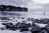 Black and white toned photo. Beach and sea