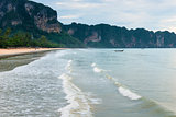 Thai wooden boat on the waves in the bay of Krabi resort, Thaila