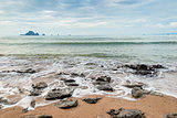 Sea foam of the Andaman Sea and rocks on the shore, beautiful sc