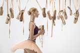 Blonde ballerina with pointe shoes