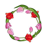 Round frame of red and pink tulip flowers with place for text