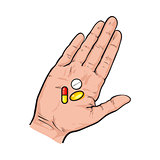 Hand holding three colorful pills, tablets in open palm