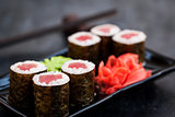 Fresh delicious tuna maki sushi rolls on dark background