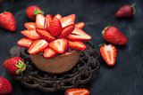 Mini chocolate cheesecake  dessert decorated with fresh strawber