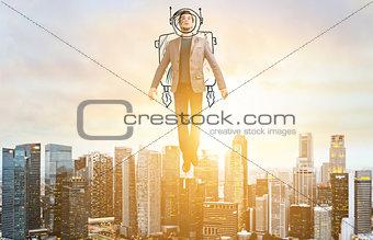 Business man hover over city skyline