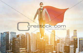 Business super hero hover over city skyline