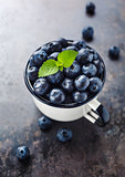 Healthy blueberries in a cup.