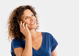 Happy woman talking at phone