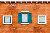 Window on the orange brick wall
