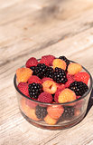Organic golden and red raspberries mixed with blackberries