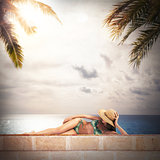 Girl in bikini sunbathes