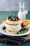 Cottage cheese pancakes with blueberries and mint