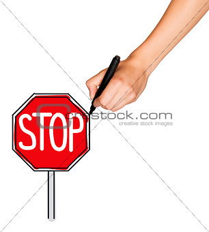 A female hand holds marker and draws stop sign