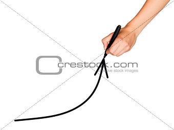 A female hand holds marker and draws an arrow up