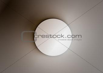 Top view of a white cylinder. Dark background