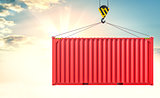 Crane hook and cargo container on sky background