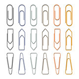 Set of different metal paper clips on white