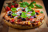 Traditional homemade pizza with tomatoes and olives