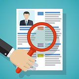 View Resume with magnifying glass.