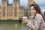 Sad Thoughtful Woman Drinking Coffee in London by Big Ben