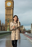 Woman Drinking Coffee Talking on Cell Phone, Big Ben, London, En