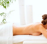 Young woman laying on massage table