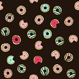 Seamless vector pattern with doodle hand drawn donuts.