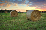 Hay bales in the Hawkesbury fields with a pretty sunrise sky beh