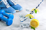 Sport composition with sports equipment glass water with lemon m