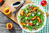 peaches, arugula, prosciutto and goat cheese salad with balsamic