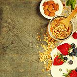 Healthy Breakfast set with granola, honey, almond milk and berri